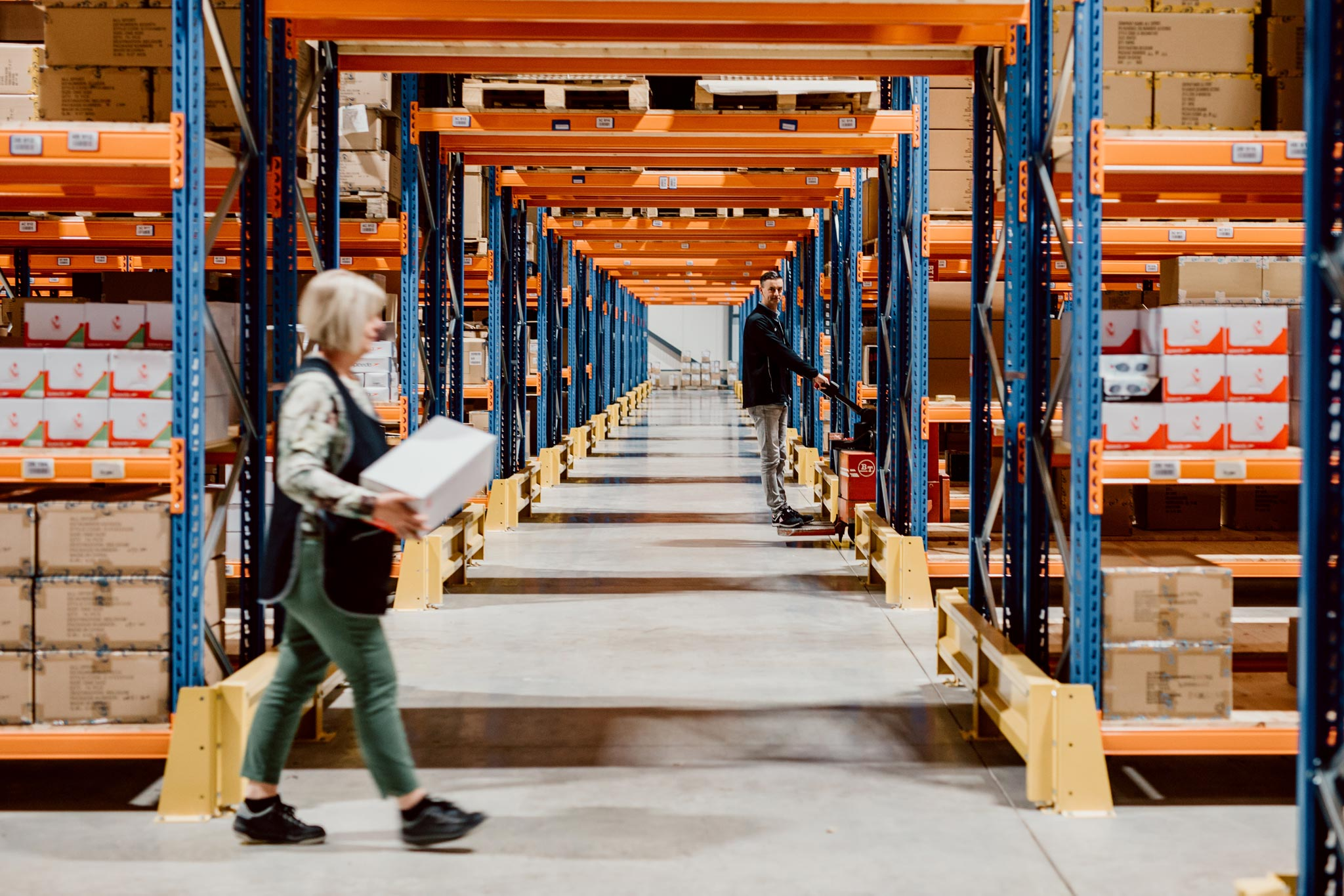 All Sport employees working in a huge clean and tidy warehouse